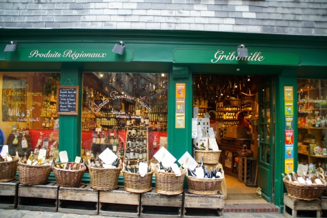 Window displays in Honfleur, Normandy, make food shops irresistible.
