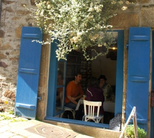 You could climb through this window and join these people for lunch in Brittany.
