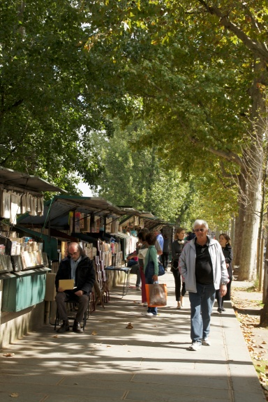 "Strolling among the ""bouquinistes"" along the Seine in Paris."