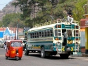 In Guatemala and other Central American countries, American schools buses receive an artful redecoration, shown here with a tuk-tuk.