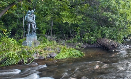 A statue of Hiawatha and Minnehaha ala the Henry Wadsworth Longfellow poem, sits adjacent to Minnehaha Creek.