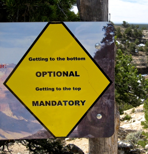 The reflection of our destination in a warning sign as we start our descent into the Grand Canyon, Arizona.