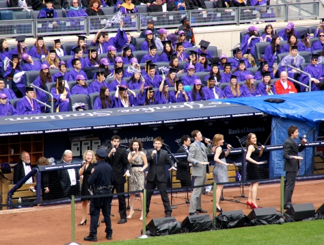 """I'll make a brand new start of it in old New York,"" from Frank Sinatra's ""New York, New York."" Part of the graduation festivities at New York University, which is held at Yankee Stadium."