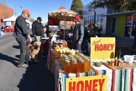 selling honey at Las Cruces Farmers Market www.offthebeatenpagetravel.com