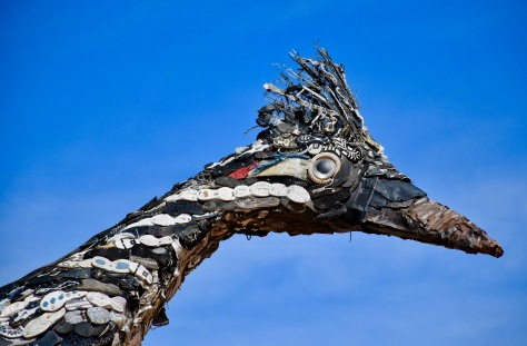 closeup of roadrunner statue made of trash in New Mexico