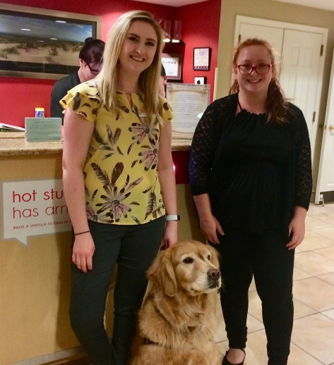 two women greeting golden retriever at TownPlace Suites Las Cruces offthebeatenpagetravel.com