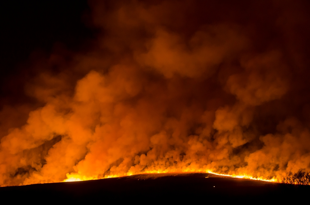 fire on flint hills prairie at night'